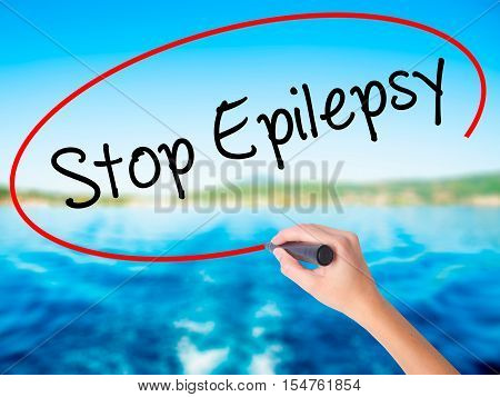 Woman Hand Writing  Stop Epilepsy With A Marker Over Transparent Board