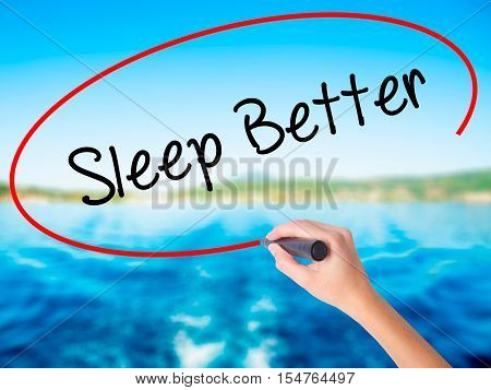 Woman Hand Writing Sleep Better With A Marker Over Transparent Board