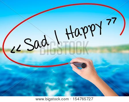 Woman Hand Writing Sad - Happy With A Marker Over Transparent Board.