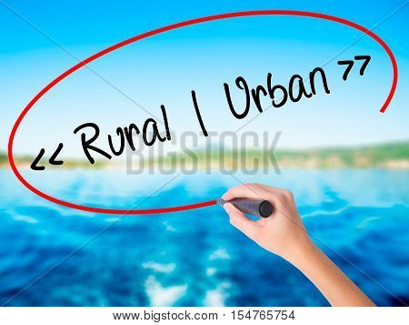 Woman Hand Writing Rural - Urban With A Marker Over Transparent Board.