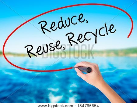 Woman Hand Writing Reduce Reuse Recycle With A Marker Over Transparent Board.