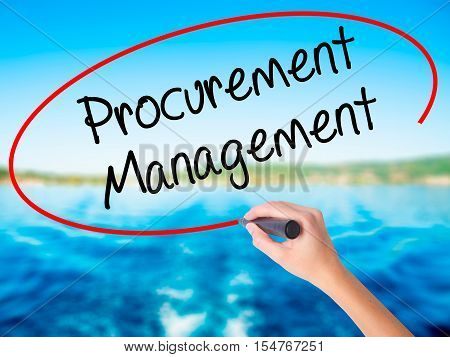 Woman Hand Writing Procurement Management With A Marker Over Transparent Board.