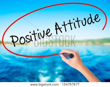 Woman Hand Writing Positive Attitude With A Marker Over Transparent Board.