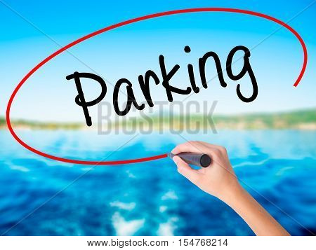 Woman Hand Writing Parking With A Marker Over Transparent Board