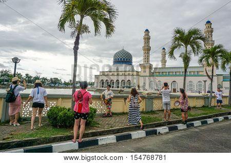 Kota Kinabalu,Sabah-Oct 20,2016:Tourists are visiting floating mosque in Kota Kinabalu.The Kota Kinabalu City Mosque is the second main mosque in Kota Kinabalu,Sabah after State Mosque in Sembulan.