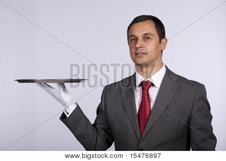 businessman showing you a solution (copyspace over the tray)