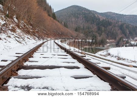 Railroad covered with snow in winter season