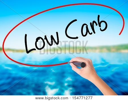 Woman Hand Writing Low Carb With A Marker Over Transparent Board
