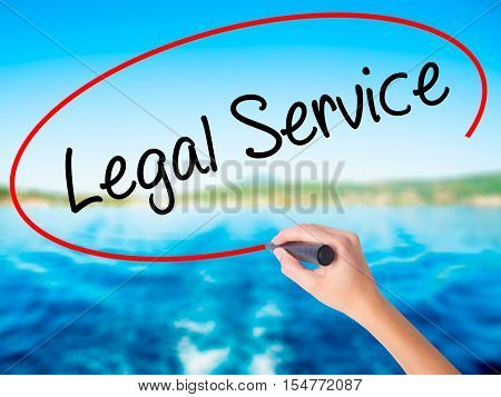 Woman Hand Writing Legal Service With A Marker Over Transparent Board