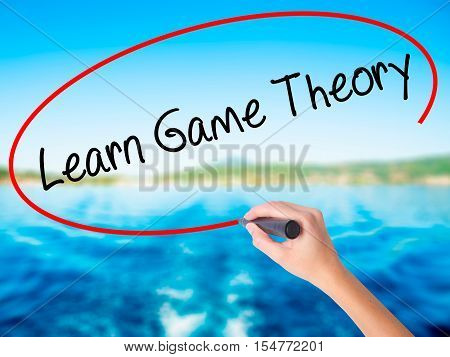 Woman Hand Writing Learn Game Theory With A Marker Over Transparent Board