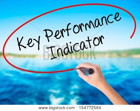 Woman Hand Writing Key Performance Indicator With A Marker Over Transparent Board.