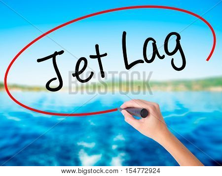 Woman Hand Writing  Jet Lag With A Marker Over Transparent Board