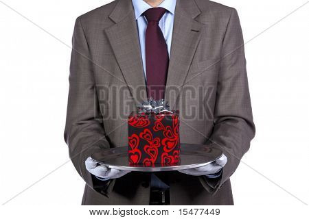 Businessman holding a luxury valentine present in silver platter