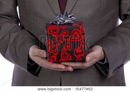Businessman holding a wrapped Valentine present