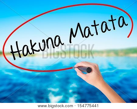 """Woman Hand Writing Hakuna Matata (swahili Phrase; It Means """"no Worries"""") With A Marker Ove"""