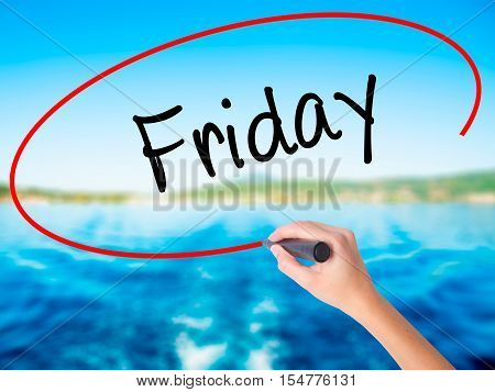 Woman Hand Writing Friday With A Marker Over Transparent Board