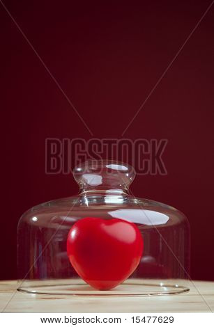 Red heart inside a glass dome (selective focus)