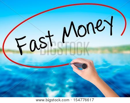 Woman Hand Writing Fast Money  With A Marker Over Transparent Board