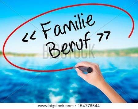 Woman Hand Writing Familie Beruf (family Occupation In German) With A Marker Over Transparent Board