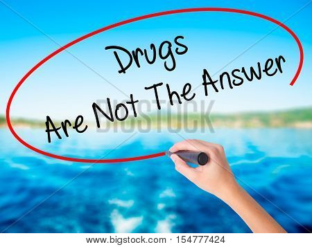 Woman Hand Writing Drugs Are Not The Answer With A Marker Over Transparent Board