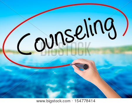 Woman Hand Writing Counseling With A Marker Over Transparent Board