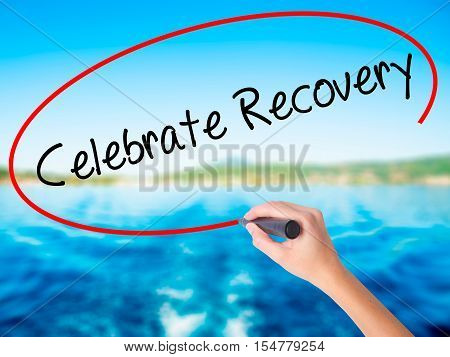 Woman Hand Writing Celebrate Recovery With A Marker Over Transparent Board