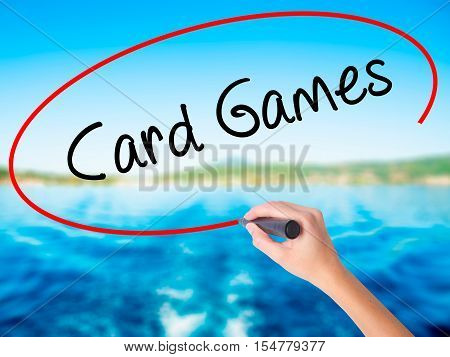Woman Hand Writing Card Games With A Marker Over Transparent Board