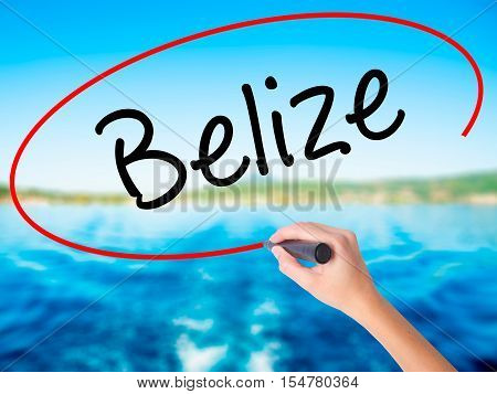 Woman Hand Writing Belize With A Marker Over Transparent Board