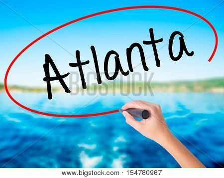 Woman Hand Writing Atlanta With A Marker Over Transparent Board