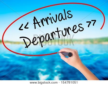 Woman Hand Writing Arrivals - Departures With A Marker Over Transparent Board.