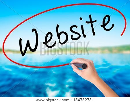 Woman Hand Writing Website With A Marker Over Transparent Board
