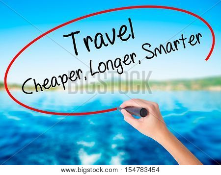 Woman Hand Writing Travel Cheaper Longer Smarter  With A Marker Over Transparent Board