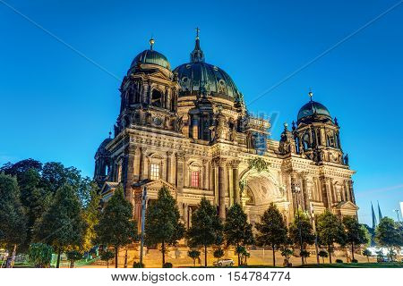 The illuminated Dom in Berlin, Germany, in the earl morning