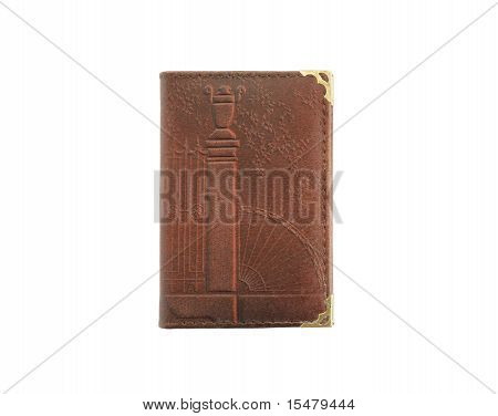 Traditional paper notebook with leather cover isolated on white