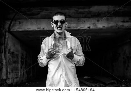 crazy handsome guy effectively tearing his shirt