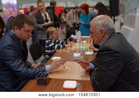 ST. PETERSBURG, RUSSIA - OCTOBER 20, 2016: People play Go during the China Day in Pulkovo airport. The event is organized by the airport administration, three and the General Consulate of China