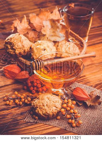 muffins with tea and honey. Autumn Still Life