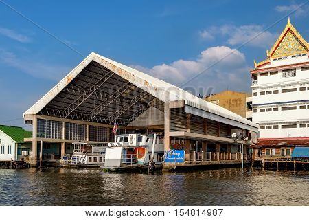 Bangkok, Thailand - December 8, 2015: Parking for boats under a canopy near Wat Soi Thong. It is on the bank of the river in northern Bangkok along the regular route of the Chao Phraya river boats.