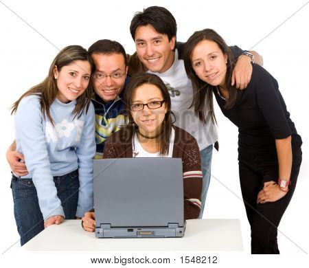 Group Of Students On A Laptop Computer