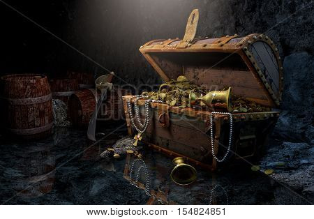Old pirate's chest with treasures in the dark cave