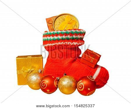 Christmas stocking with presents and christmas balls isolated on white background. Selective focus