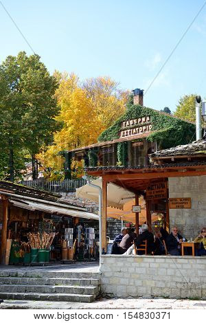 METSOVO VILLAGE GREECE-OCTOBER 11: The tourists enjoing their vacation in Metsovo village on October 11 2013 in Metsovo Greece. Up to 12 mln tourists is expected to visit Greece in year 2013
