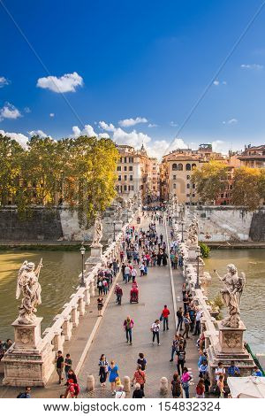 Rome, Italy, October 15th, 2016: People crossing Sant'Angelo Bridge across the Tiber river, aerial view from the Castle Sant'Angelo, Mausoleum of Hadrian, Rome, Italy