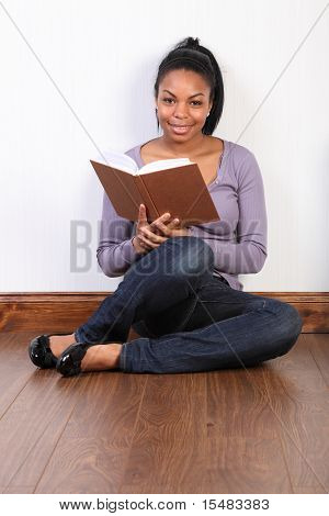 Beautiful African American Girl Reading A Book