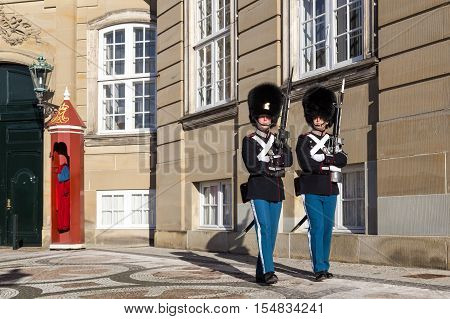 Copenhagen, Denmark - November 11, 2016: Two royal life guards at Amalienborg Palace
