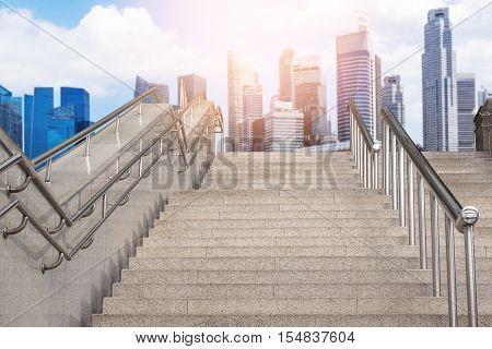 Marble staircase railing stainless steel with the skyscrapers background.