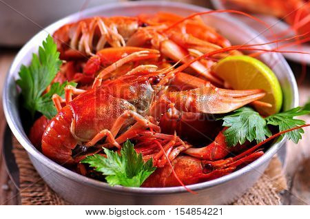 Red boiled crayfish (crawfish) on wooden background