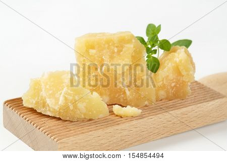 parmesan cheese and oregano on wooden grater - close up