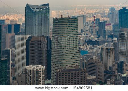 Tokyo Japan - September 26 2016: Aerial view since shot off Observatory tower. Close up of the Mori towers surrounded by a multitude of highrise buildings.