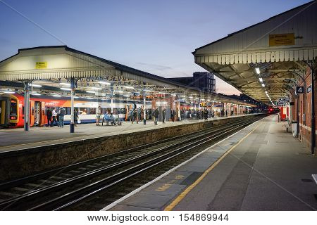 Basingstoke, UK. 2nd September 2016. A long distance service to Exeter St Davids is about to depart from platform 2. The platform is busy with shoppers and workers at the end of the day.
